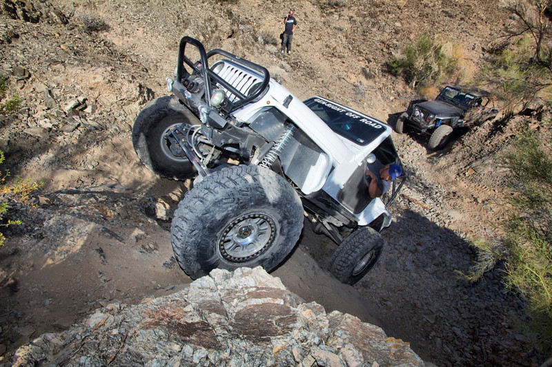 white jeep tj with genright fenders bumper armor rock crawling